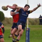 Harbour fullback Logan Allen (left) competes for the ball with Dunedin replacement winger Will...