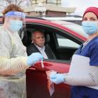 WellSouth nurse Rachel Hall (left) places the swab collected from Gore Mayor Tracy Hicks in the...