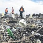 Millions of pieces of plastic from the Fox River landfill were strewn through riverbed and forest...