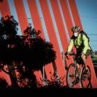 A masked cyclist rides through Melbourne. Photo: Getty