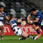 Auckland replacement back Simon Hickey is felled in an illegal tackle by Otago midfielder Sio...