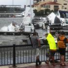 People look at damaged boats in the Palafox Pier Yacht marina after Hurricane Sally passed...