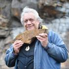Harry Albert holds a piece of pillow lava found in the rock formations below First Church. He is...