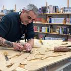Carver Greg Houkamau works on a piece which represents the Maori legend of Tane seeking Nga Kete...