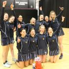 The St Hilda's Collegiate team celebrates after winning the Otago-Southland secondary schools...