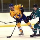 Stampede player Stefan Amston (left) gets a pass away despite the attentions of the Dunedin...