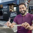 Wasseim Alsati outside his mobile barbershop on Victoria St. Photo: Geoff Sloan