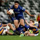 Josh Ioane makes a break for Otago against Bay of Plenty last night. Photo: Getty Images