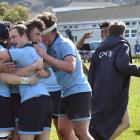 The King's High School First XV celebrates after beating Southland Boys' High School at King's on...