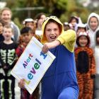 St Mary's School pupil Stani Cherkun (10) celebrates the move back to Alert Level 1 with fellow...