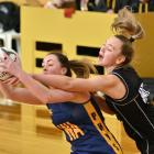 Physed A's Emily Henderson clutches the ball as Southern Magpies' Bridie Burns tries to snatch it...