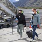 Passengers arrive in Queenstown on an Air New Zealand flight from Auckland at ...