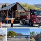 The Wanaka lakefront log cabin is moved on the back of a truck from its previous lakefront site ...