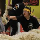 Trinity Page-Stevens, of Waimate, skirts the fleece at last year's Waimate Spring Shears. PHOTO:...
