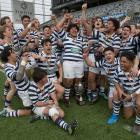 The Otago Boys' High School first XV celebrates winning the Otago Premier Schools rugby final at...