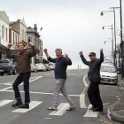 Port Chalmers residents (from left) Jonathan Holloway, Pete Cole and Robert Scott celebrate a...