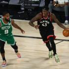 Toronto Raptors forward Pascal Siakam looks to drive as he is guarded by Brad Wanamaker of the...