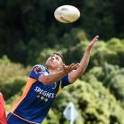Otago winger Freedom Vahaakolo soars in front of a Otago assistant coach Lee Allan at training at...