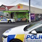 Police at the 10 O'Clock Dairy in Prince Albert Rd, in Dunedin, yesterday. PHOTO: PETER MCINTOSH