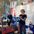 Enviroschools Otago regional co-ordinator Robyn Zink has a pair of undies to be used in the soil...