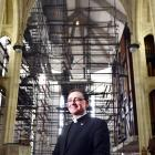 The Dean of St Paul's Cathedral, Dunedin, the Very Rev Dr Tony Curtis, shows the large...