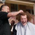King's High School pupil Robbie Heller gets his hair shaved by Bloke barber Rewi Pomare at school...