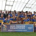 Taieri players and staff celebrate with the Speight's Championship Shield after beating...
