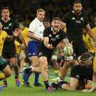 TJ Perenara clears the ball from a ruck during the All Blacks loss to Australia. Photo: Getty Images