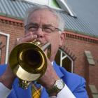Mosgiel Brass Band musical director Phil Craigie, pictured playing the cornet, says players are...