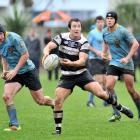 University flanker Dale Jarden (left) shadows Southern halfback Robbie Smith during a Dunedin...