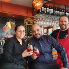 Pedro's By The Lake co-owners Maria De Leon, left, and Damian Brown, centre, toast the opening...