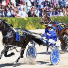 Natalie Rasmussen and Ultimate Sniper won the New Zealand Trotting Cup last year. Photo: NZH