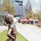 A masked statue of Fearless Girl in Melbourne's Federation Square. Photo: Chris Putnam/Barcroft...
