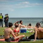 Police patrol at St Kilda Beach in Melbourne yesterday. Photo: Getty