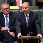 Australian Treasurer Josh Frydenberg delivers the budget in the House of Representatives in...
