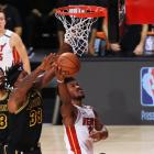 Miami Heat forward Jimmy Butler takes the ball to the hoop as Los Angeles Lakers centre Dwight...