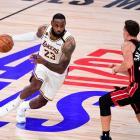 Los Angeles Lakers star LeBron James drives at Miami Heat guard Duncan Robinson during Monday's...