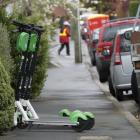 Lime scooters parked on Gladstone Rd in Dunedin yesterday. PHOTO: GERARD O'BRIEN