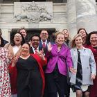 Newly-elected Labour Party MPs celebrate on the steps of Parliament in Wellington yesterday after...