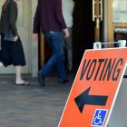 People head for polling booths to cast their vote in Dunedin this morning. Photo by Peter McIntosh