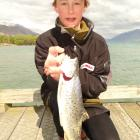Seamus Hickey (14), of Christchurch, shows off one of the brown trout he caught off the Glenorchy...