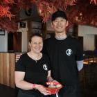Gillian and Yuya Sugiyama with a bowl of ramen in their Takeichi Ramen restaurant that opened...