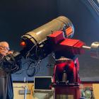 Dunedin Astronomical Society past president and life member Ash Pennell checks the large...