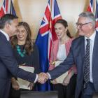 Greens co-leaders James Shaw and Marama Davidson and Labour leader Jacinda Ardern and deputy...