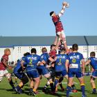 Southland lock Mike McKee climbs high to snaffle lineout ball during a match against Otago at...