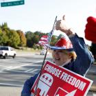 A Trump supporter holds a US flag on Election Day in Powder Springs, Georgia. Photo: Reuters