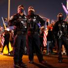 "Police officers at the ready during a ""Stop the Steal"" protest at Clark County Election Center in..."