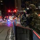 National Guard members stand guard near Philadelphia City Hall after police probing an alleged...