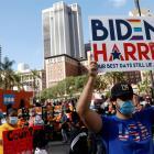 People react as media announce that Democratic U.S. presidential nominee Joe Biden has won the...