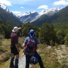 Graham Batchelor and friend Caroline Thomson at Shovel Flat beneath Mt Aspiring and the Breakaway...